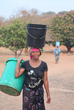 Carrying Water - No taps in these homes.
